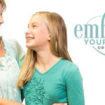 Embrace Your Smile Orthodontics - an orthodontist in Santa Clarita - Photo of a mom and daughter smiling at one another